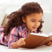 shutterstock_377676679 girl reading 2